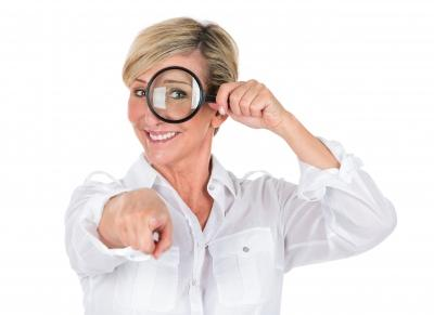 """Manager Woman Looking Through Magnifying Glass"" by Flare courtesy of FreeDigitalPhotos.net"